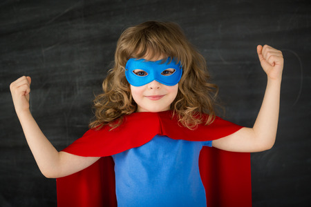 Super kid against school blackboard photo