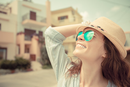 Hipster girl in summer city photo