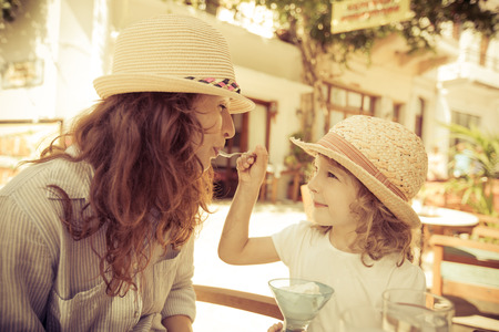 Hipster woman and girl in summer cafe