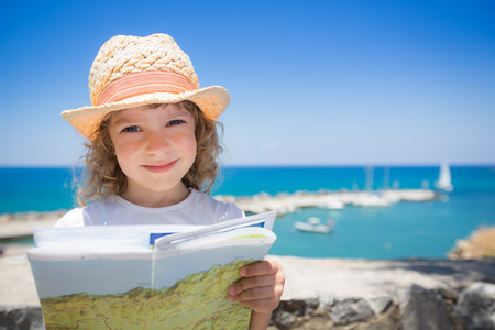 Child at the beach. Summer vacations concept photo