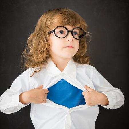 vintage power: Super hero child in class Stock Photo