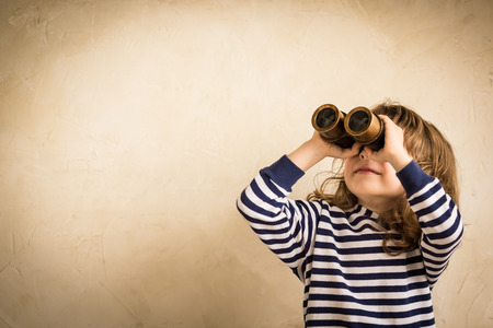 spyglass: Smiling child with spyglass. Stock Photo