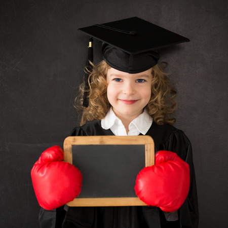 Smart kid in class. Happy child against blackboard. Back to school. Education. Knowledge is power concept Stock Photo - 28647018