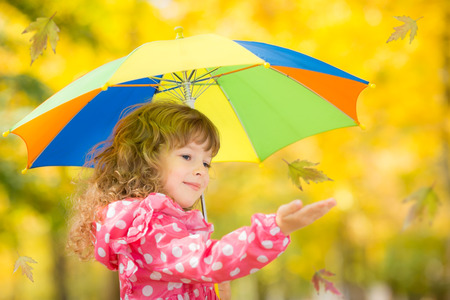 Happy child playing outdoors in autumn park Stock Photo - 30826126