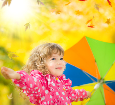 Happy child playing outdoors in autumn park Stock Photo - 31161229