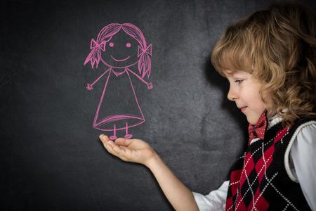 smart kids: Smart kids in class. Happy children against blackboard. Education concept Stock Photo