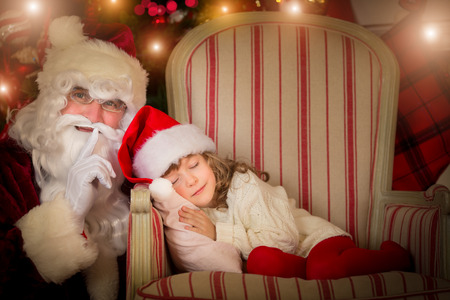 Santa Claus and happy kid. Children dream. Christmas holiday concept. Xmas miracle photo