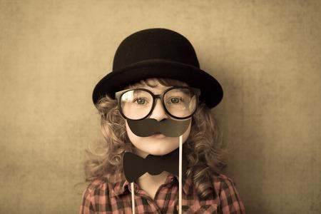 Happy hipster kid in studio photo