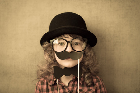 nerd girl: Happy hipster kid in studio