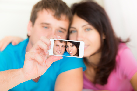 Dating young couple in love taking selfie at home photo