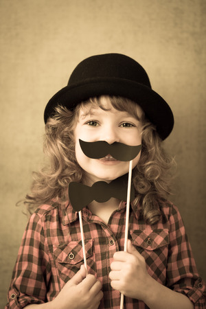 Funny hipster kid in studio. Retro toned photo