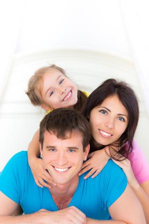 Happy family having fun at home photo