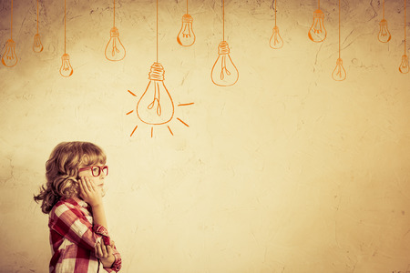 geek: Hipster kid thinking. Idea concept. Drawing bulb lump. Retro toned