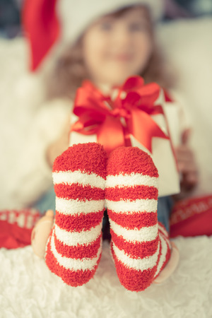 Child holding Christmas gift. Xmas holiday concept photo