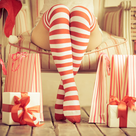 ladies fashion: Sexy woman legs. Christmas concept