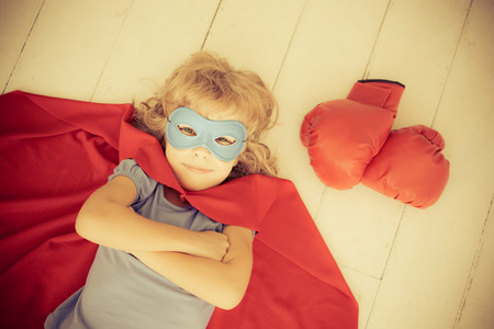 boxing gloves: Superhero kid with red boxing gloves. Retro toned Stock Photo