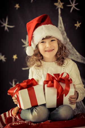 Child holding Christmas gift.  photo