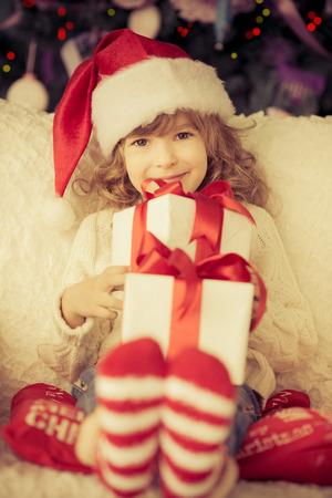 Child holding Christmas gift. photo