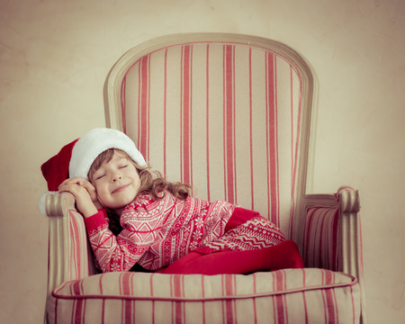 holding a christmas ornament: Child holding Christmas gift. Xmas holiday concept Stock Photo