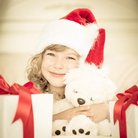 Child holding Christmas gift photo