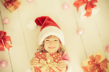 Child holding Christmas gift photo