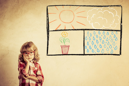 Kid looking out of the drawn open window on grunge wall photo