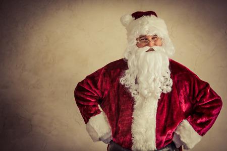 Santa Claus senior man against grunge background. Xmas holiday concept photo