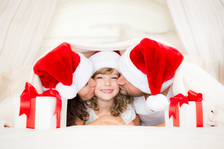 papa noel: Happy family with Christmas gift. Xmas holiday concept