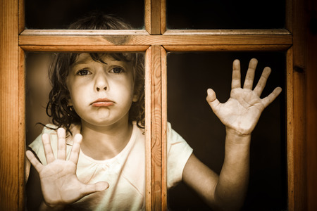boy crying: Sad child at home Stock Photo