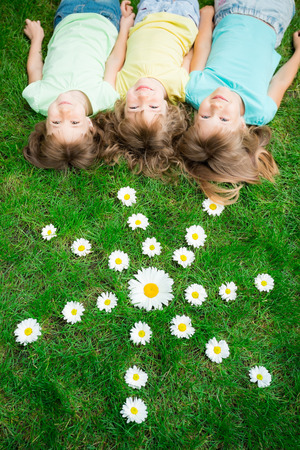 the child laughing: Group of happy children playing outdoors in spring park Stock Photo