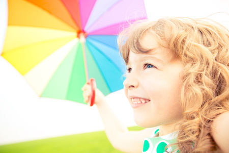 Happy child in spring field. Sunny day. Freedom concept photo