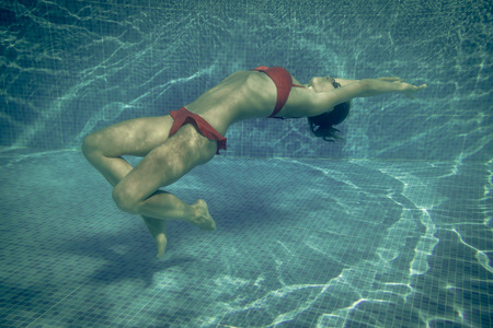 woman diving: Underwater portrait of beautiful woman. Summer vacation concept
