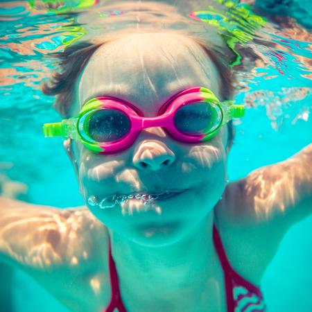 Underwater portrait of happy child. Summer vacation photo