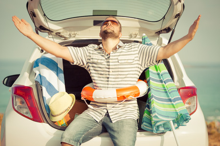 cars on the road: Man on vacation. Summer holiday and car travel concept