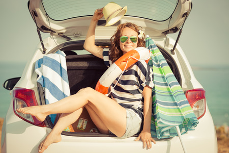 vacations: Woman on vacation. Summer holiday and car travel concept