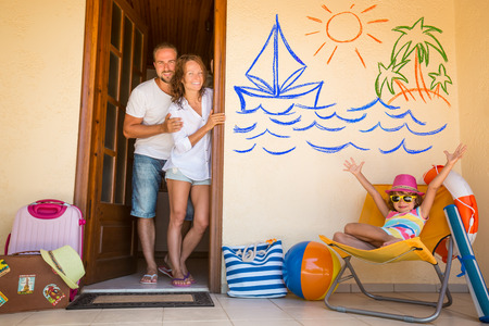 welcome home: Happy family on summer vacation. Travel and adventure concept