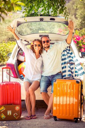 Couple going on summer vacation. Car travel concept