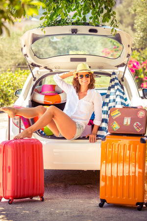 Woman going on summer vacation. Car travel concept