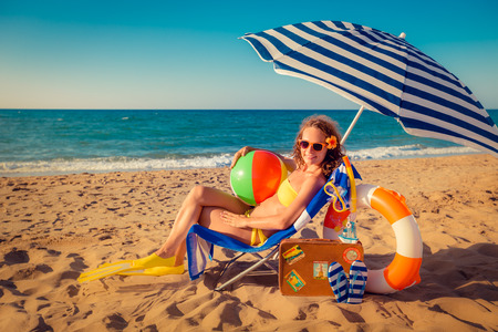 enjoy space: Happy young woman sitting on the beach. Summer vacation concept