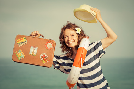 adventure holiday: Woman against summer sea and sky background