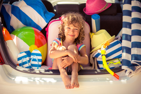 Child going on summer vacation. Car travel concept 스톡 콘텐츠