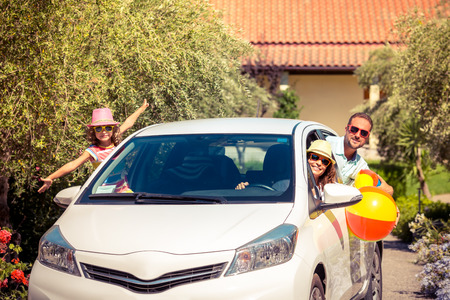 family with three children: Family going on summer vacation. Car travel concept