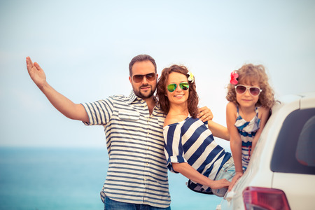 trips: Family on vacation. Summer holiday and car travel concept