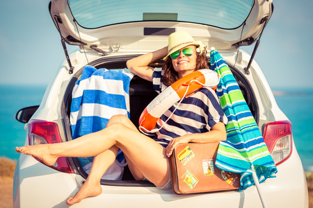 trunks: Woman on vacation. Summer holiday and car travel concept