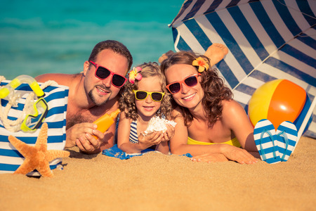 family with three children: Happy family lying on the beach. Summer vacation concept