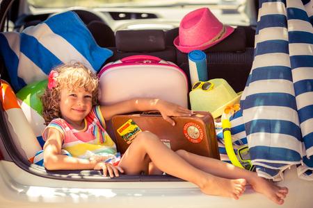 Child going on summer vacation. Car travel concept 版權商用圖片