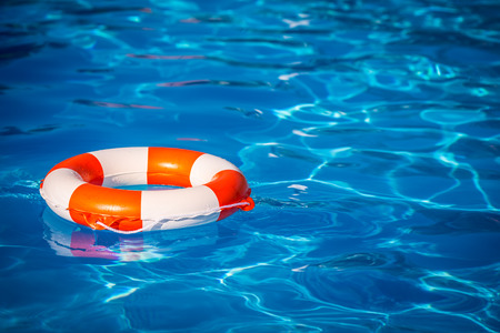 life buoy: Life buoy in swimming pool. Summer vacation concept