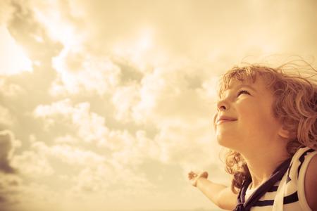 looking ahead: Sailor kid looking ahead against summer sky