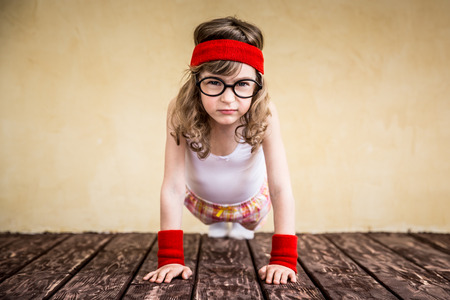 Funny strong child. Girl power and feminism concept 스톡 콘텐츠