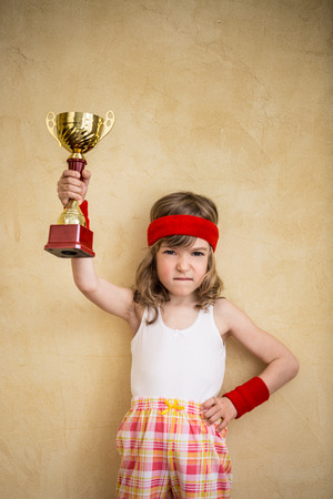 super hero: Funny strong child. Girl power and feminism concept Stock Photo
